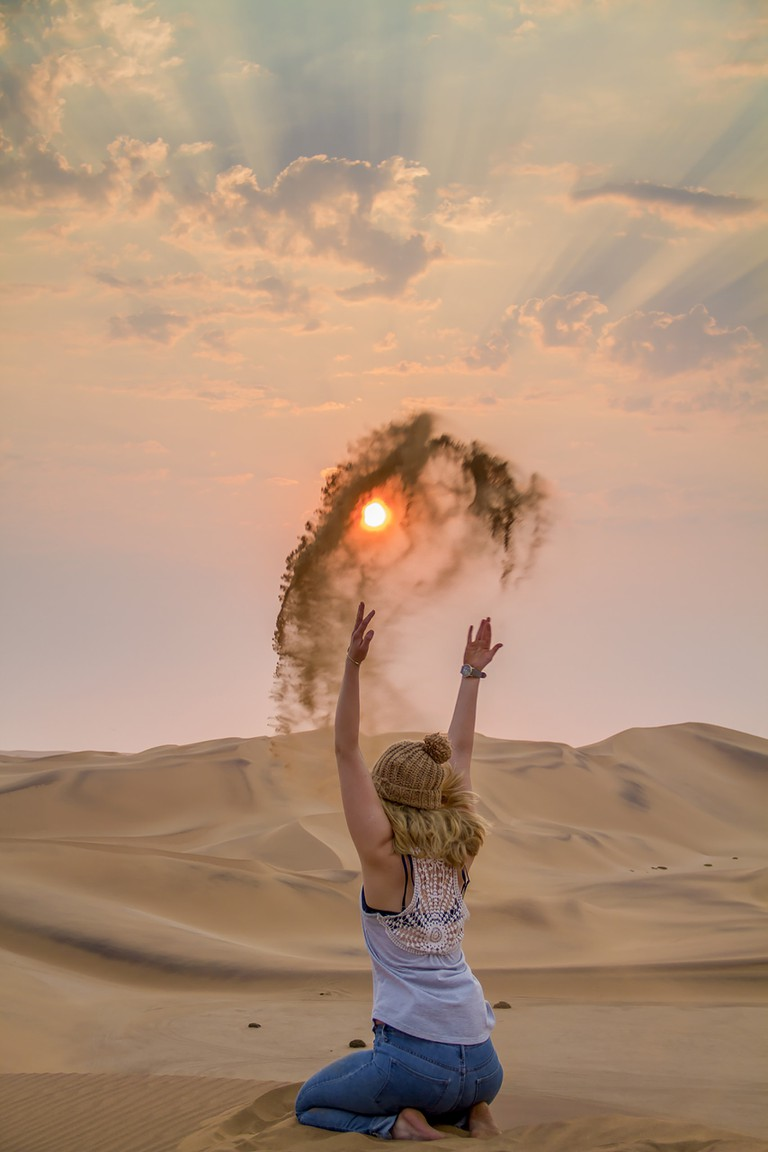 Throwing sand to the sun