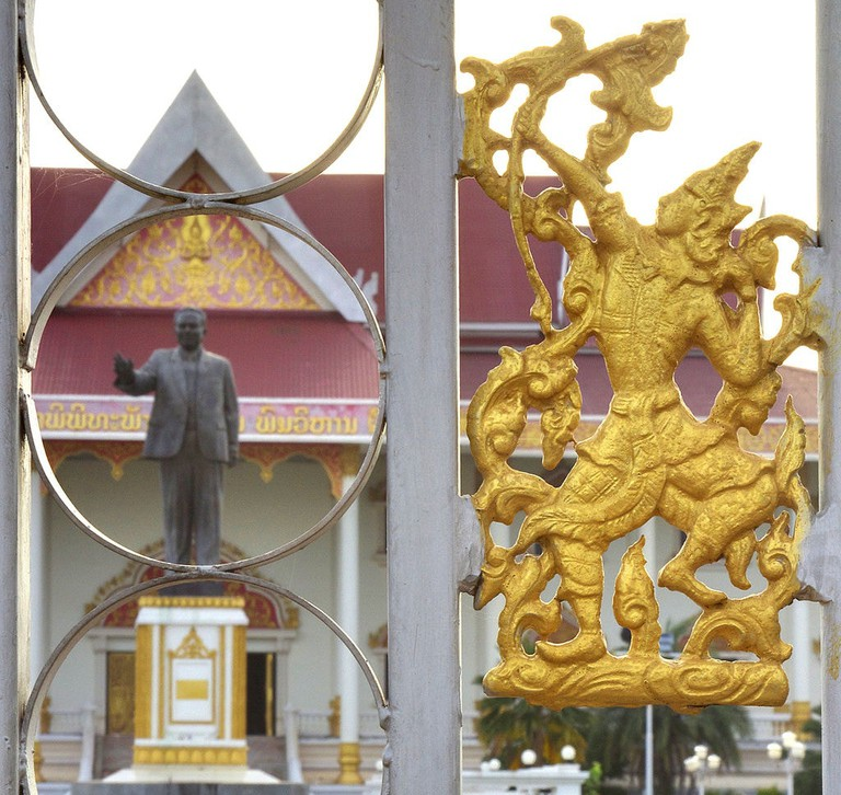 View_of_Kaysone_Phomvihane_Museum_showing_Sinxay_figure_in_front_gate_with_statue_of_Kaysone_in_the_background (1)