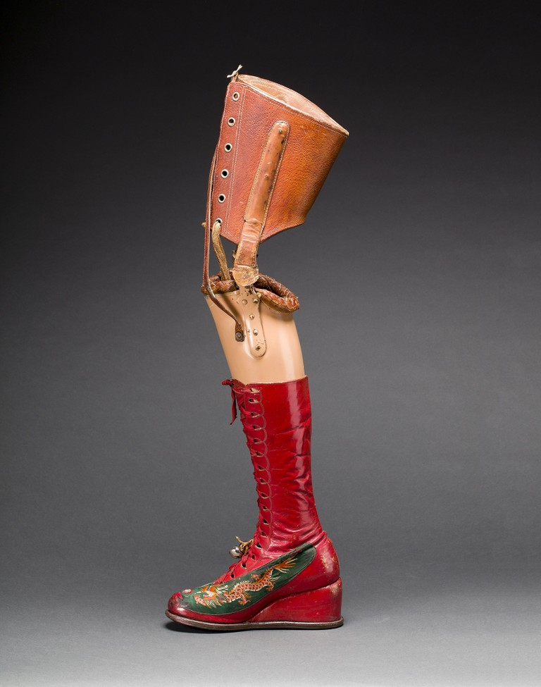 Prosthetic leg with leather boot, appliquéd silk with embroidered Chinese motifs