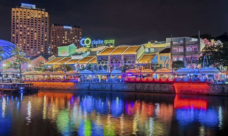 Colorful light building at night in Clarke Quay, a historical riverside quay in Singapore, located within the Singapore River Area.