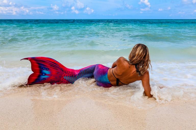 Lady in a Mermaid tail on a beach, Boracay Island, Philippines.