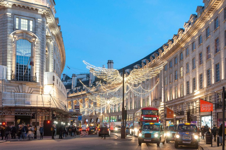 Christmas lights at dusk in Regent Street, Soho, City of Westminster, Greater London, England, United Kingdom