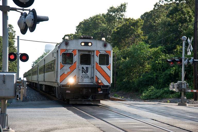 NJ transit train at crossing