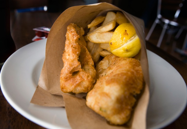 Plate of Fish and chips served in a paper cone, Fish Frenzy, Elizabeth Street Pier, Hobart, Tasmania, Australia