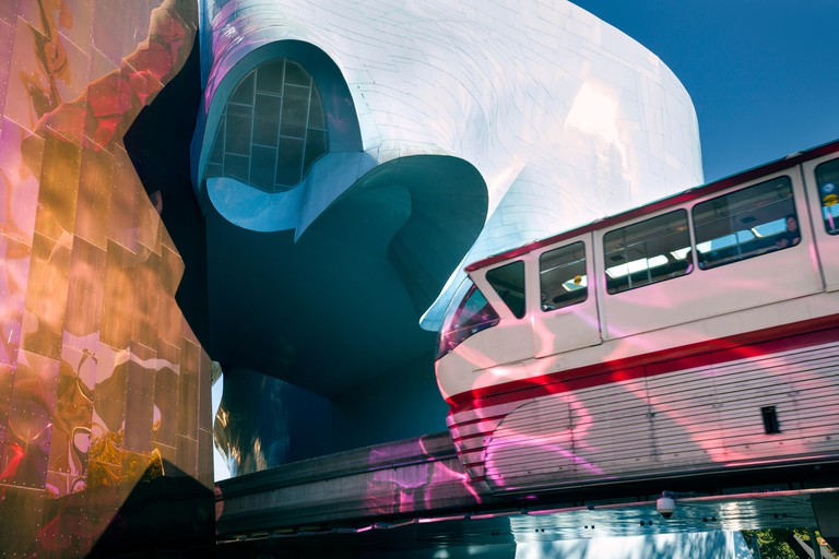 WA14138-00...WASHINGTON - The Monorail entering the tunnel through the Museum Of Pop Culture located at the Seattle Center.