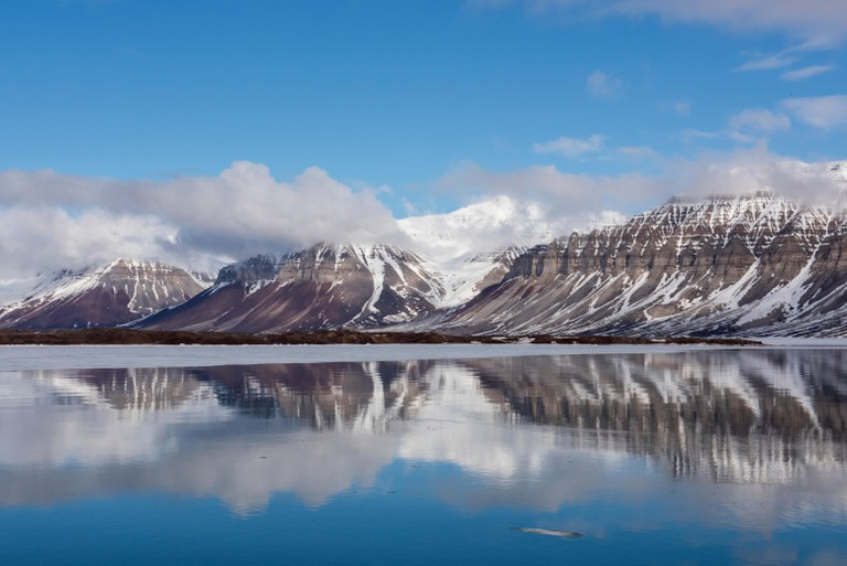 Norway, Svalbard, Spitsbergen, Isfjord. Arctic fjord reflections.