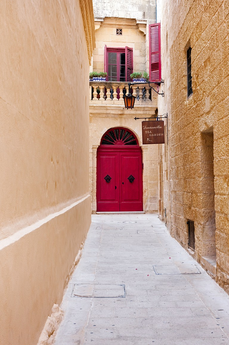 A view down one of the narrow alleys in the medieval, hill top fort of Mdina, Malta.