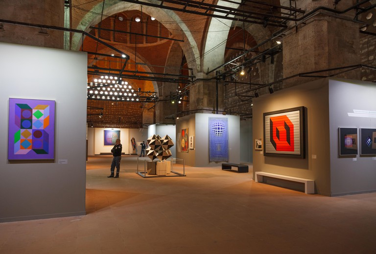 Istanbul, Turkey - FEBRUARY 27, 2017: Visitors in Tophane-i Amire, a modern exhibition hall, former cannon foundry. Victor Vasarely Retrospective exhi
