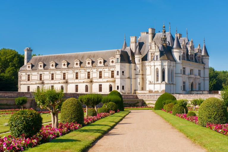 Chenonceau chateau, built over the Cher river , Loire Valley,France,on gradient blue sky background.