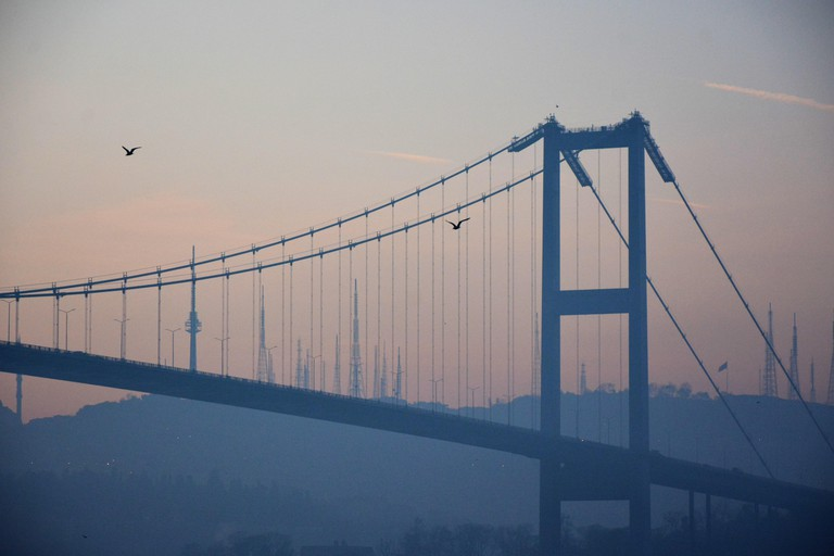 Bosphorus Bridge silhouette early in the morning while the sun is rising up