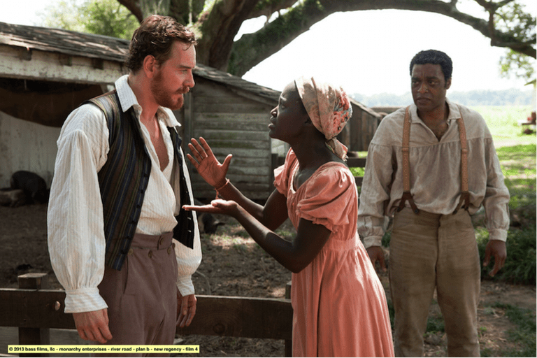 Michael Fassbender and co-star Lupita Nyong'o | © Alatele fr/Flickr