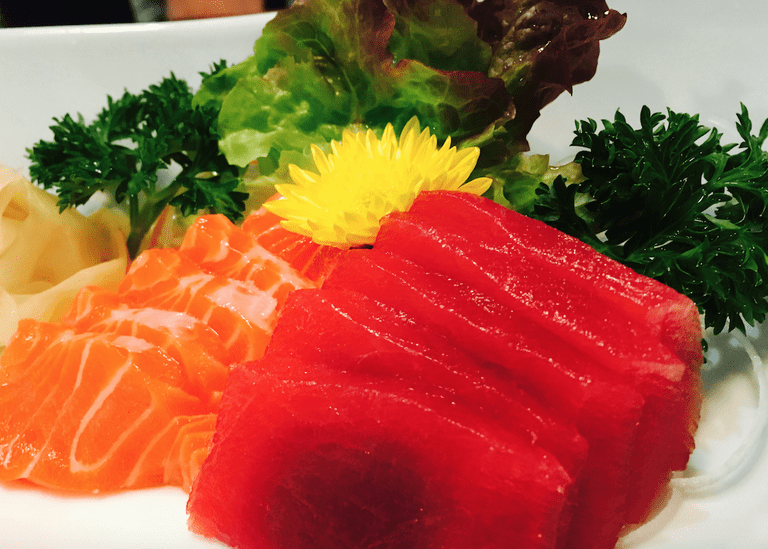 Salmon and tuna Sashmini Combination, garnished with a flower. © Jessica Poulter