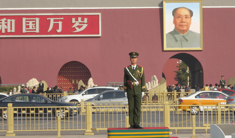 "Guard and portrait of Mao in Tiananmen Square, Beijing, ""The Story of China"""