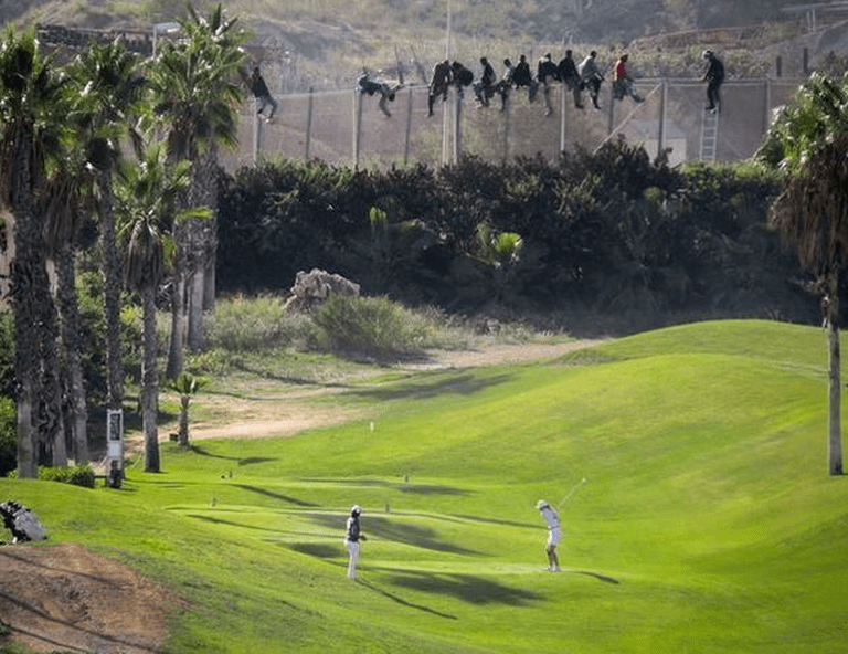 Migrants entering a Melilla Golf Course