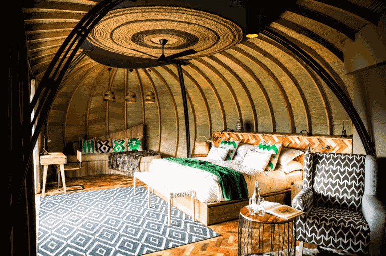 Guest bedroom interior at Bisate Lodge | Courtesy of Wilderness Safaris / Crookes & Jackson