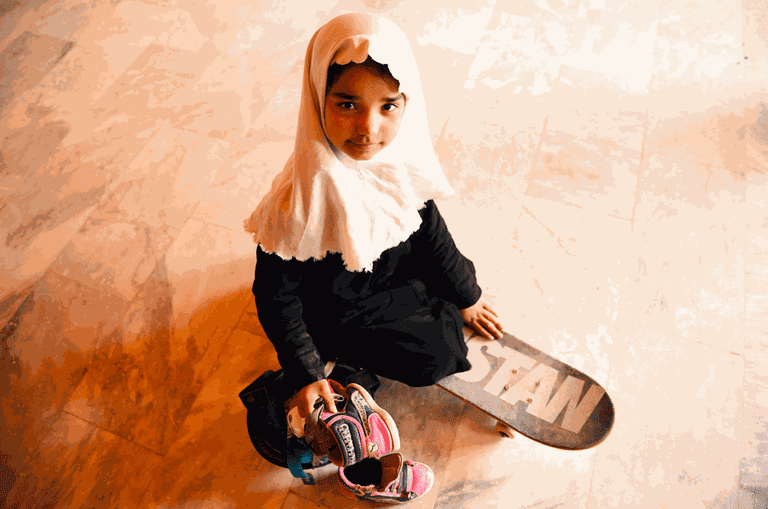 Young girl gets ready for her skate lesson