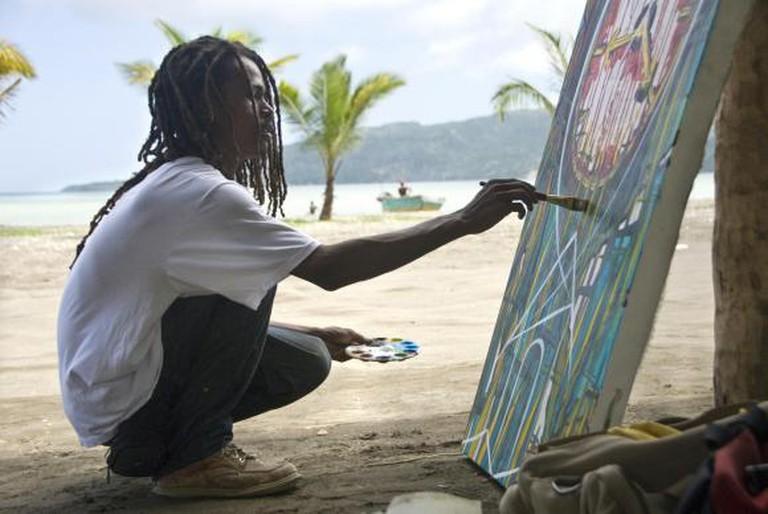 Photograph of Haitian artist Anderson Ambroise, taken by Keely Kernan.