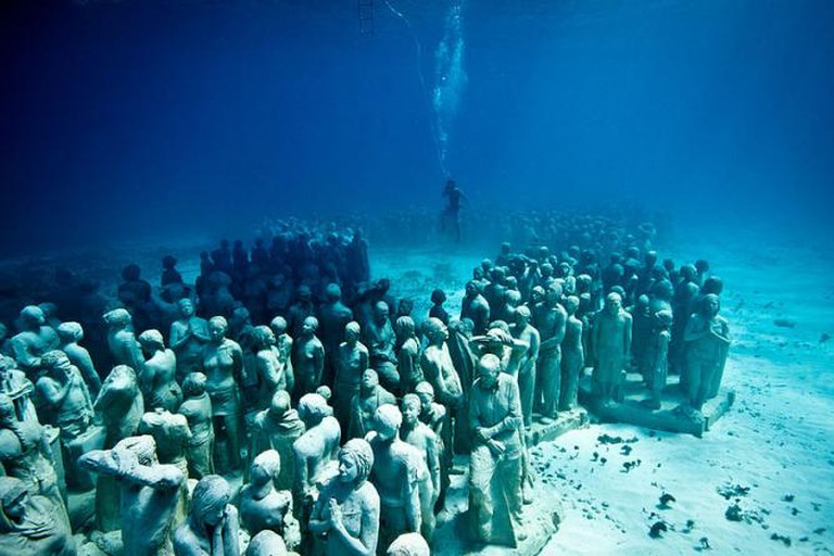 Jason deCaires Taylor sculpture of girl underwater for MUSA
