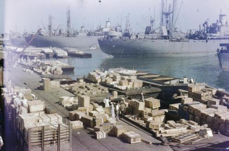 Royal Air Force parts being unloaded at Port Said, 1944   © Imperial War Museum/WikiCommons