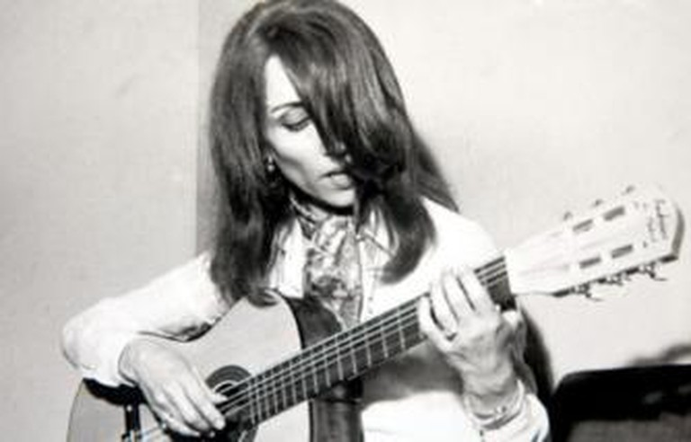 Fairuz playing guitar, 1970s