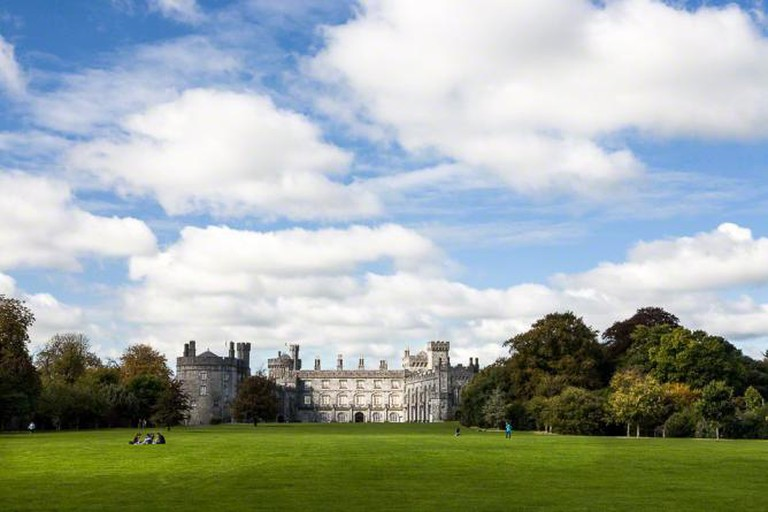 The view of Kilkenny Castle from its park.