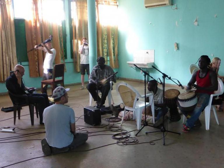 Brian Eno and Damon Albarn in studio with (L-R) Yacuba Cissoko, Samba Kouyaté and Madou Sanogo Djembe, background - David Maclean and Sammy J