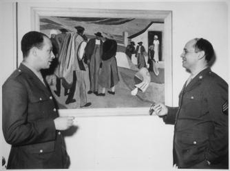 Romare Bearden (right) discussing a painting with Charles H. Alston, his first art teacher and cousin