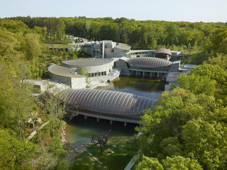 Aerial view	 of Crystal	Bridges Museum of American Art, designed by Safdie	Architects;	 photography by Timothy Hursley.