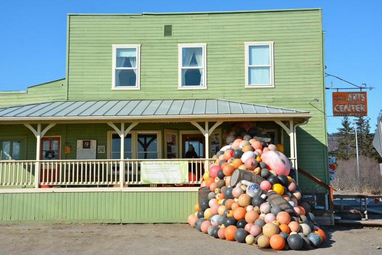 front view of Bunnell Street Arts Center including our current installation called Bouys and Barrels by Jarod Charzewski