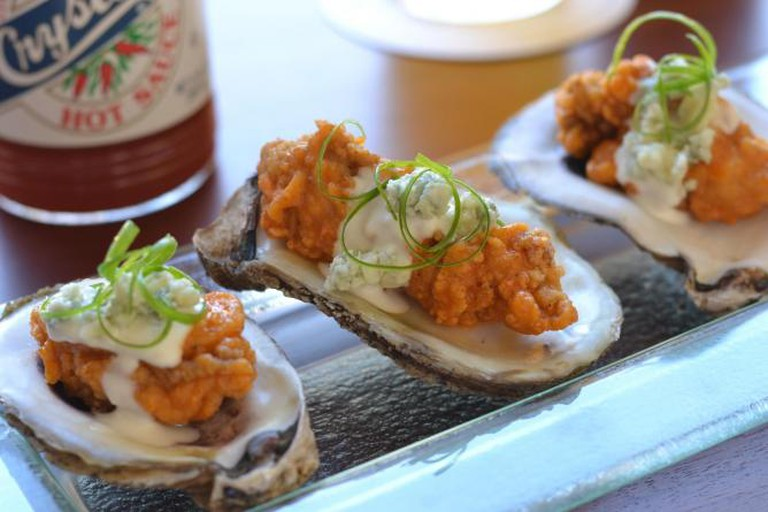 BBQ Oysters | Image Courtesy of Red Fish Grill
