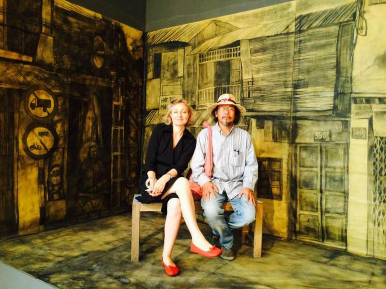 Iola Lenzi (left) with Thai artist Vasan Sitthiket seated within 'The Past Moved', an installation by Bui Cong Khanh