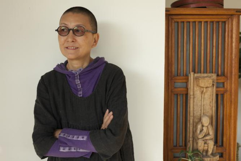 Qing Qing in her studio, image courtesy the artist and Red Gate Gallery
