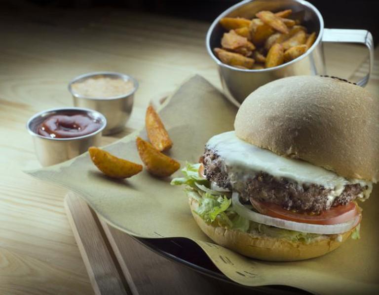 A signature burger at 19th Century Burger