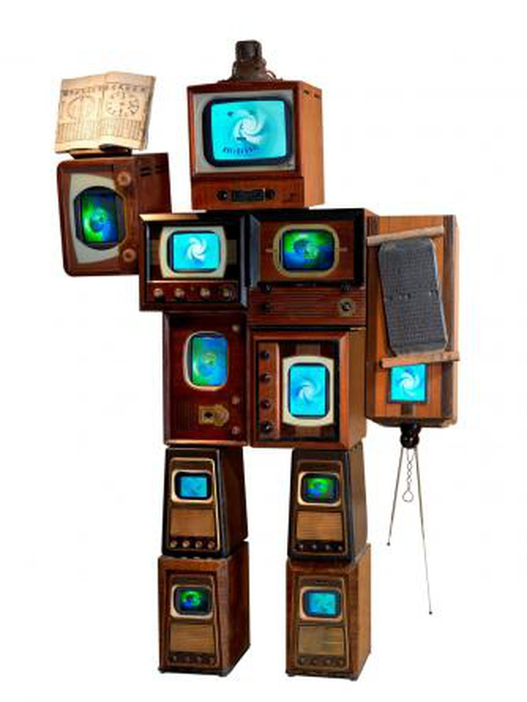 Nam June Paik, Li Tai Po, 1987. 10 antique wooden TV cabinets, 1 antique radio cabinet, antique Korean printing block, antique Korean book, 11 color TVs, 243.8 x 157.5 x 61 cm. Asia Society, New York: Gift of Mr. and Mrs. Harold and Ruth Newman, 2008.2. Photo credit: © 2007 John Bigelow Taylor Photography