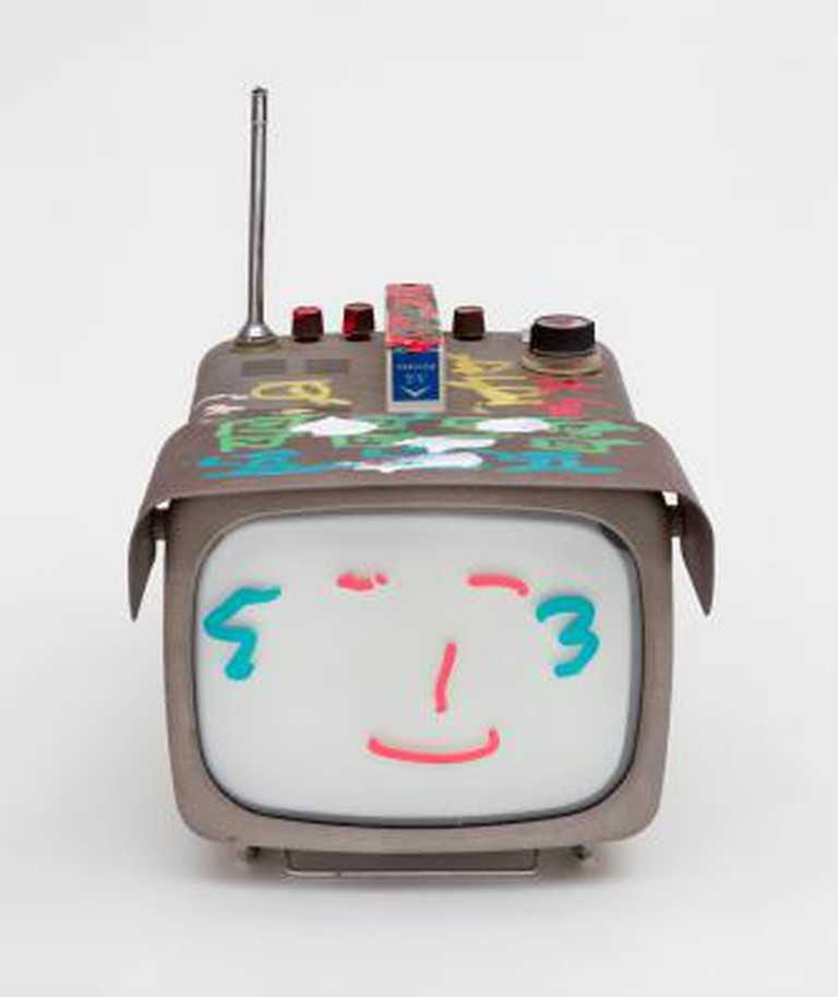 Nam June Paik, Transistor Television, 2005. Permanent oil marker and acrylic paint on vintage transistor television, 31.8 x 24.1 x 40.6 c). Nam June Paik Estate