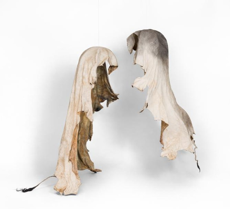 Nandipha Mntambo, Destinies Entwined, 2014. Cowhide, resin, polyester mesh, waxed cord. Left: 190 x 140 x 55cm. Right: 181 x 143 x 57cm. Courtesy of Stevenson