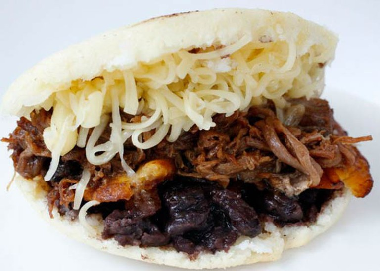 Arepa stuffed with plantains, black beans, shredded beef and cheese/
