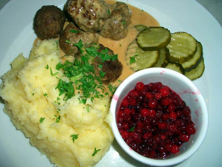 Swedish meatballs with cream sauce, mashed potatoes, pickled gherkin and lingonberry jam