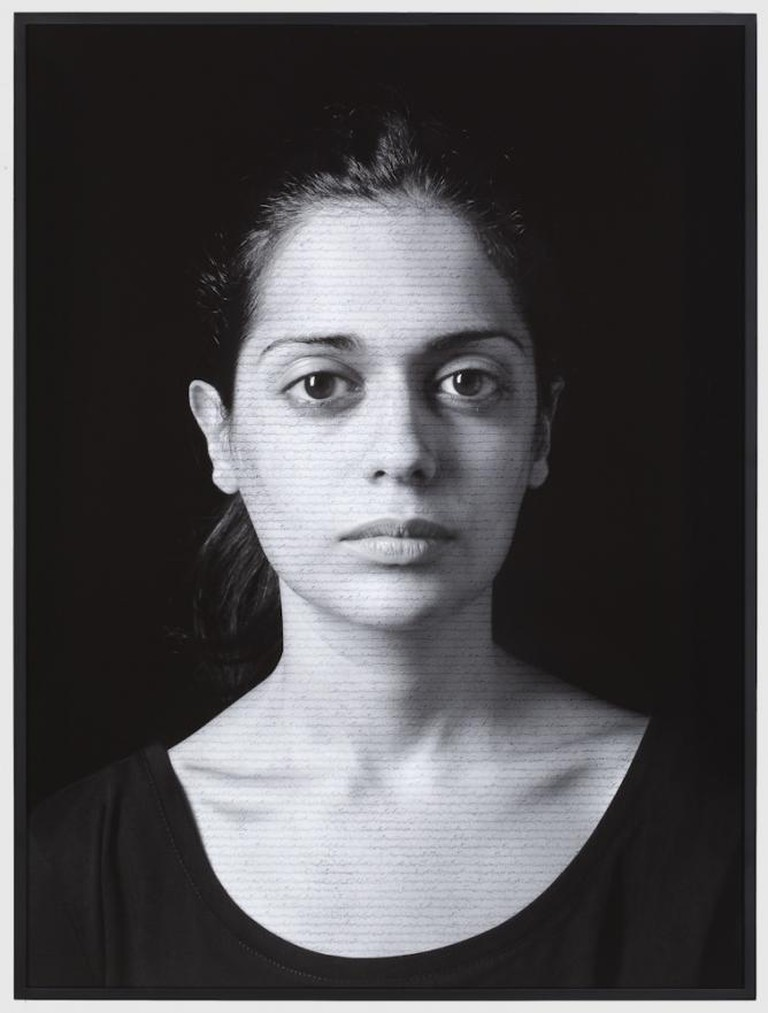 Shirin Neshat, Roja (Masses), from The Book of Kings series, 2012, ink on LE silver gelatin print, 101.6 x 76.2 cm | Courtesy of Gladstone Gallery, New York and Brussels