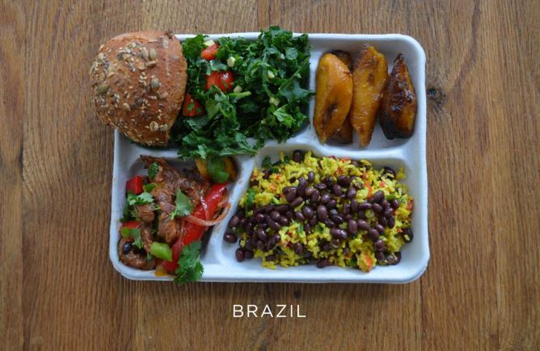 Pork with mixed veggies, black beans and rice, salad, bread and baked plantains