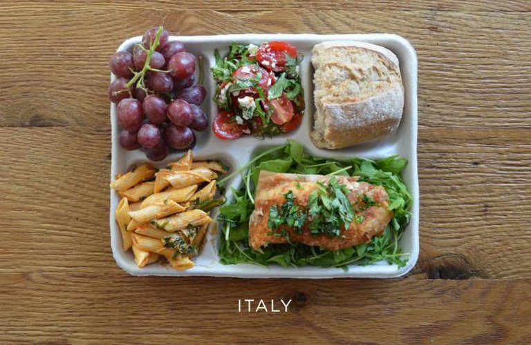Local fish on a bed of arugula, pasta with tomato sauce, caprese salad, baguette and some grapes