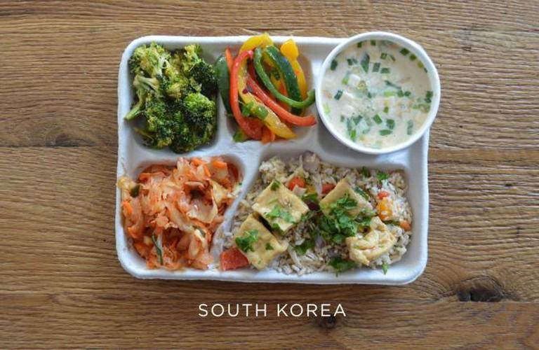 Fish soup, tofu over rice, kimchi and fresh veggies