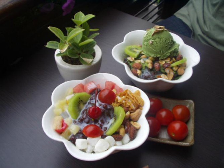Bingsu is a granola, Green Tea-Flavored Shaved Ice, Sweet Red Bean, and Rice cake dessert