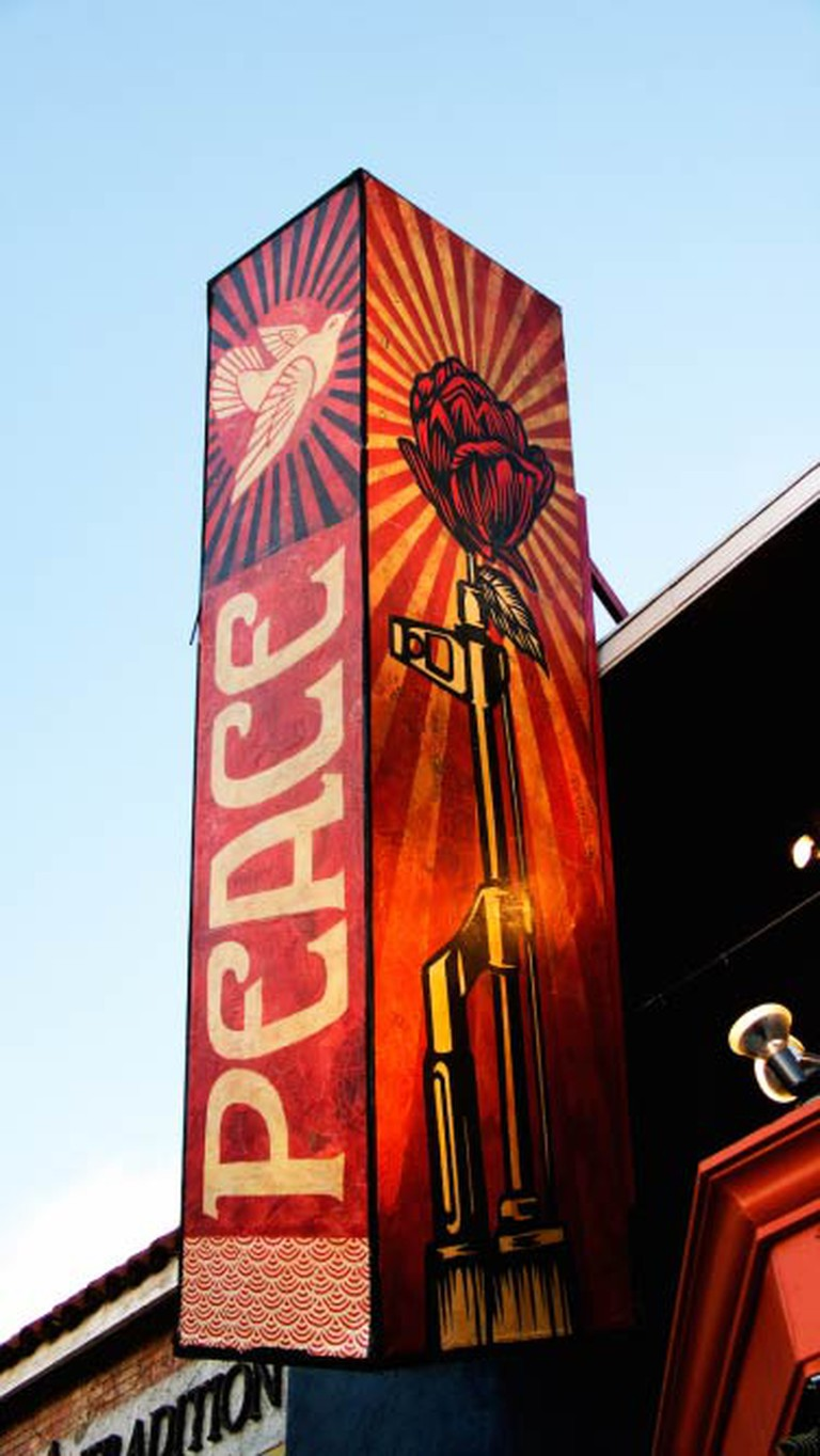 Shepard Fairey 'Peace' wall art | © John Lopez/FlickrCommons