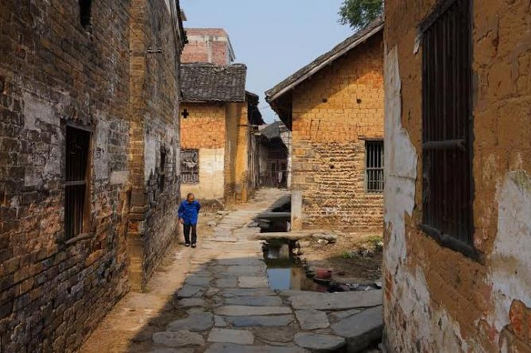 An old woman in Zhongtian village © Gaetan Reuse
