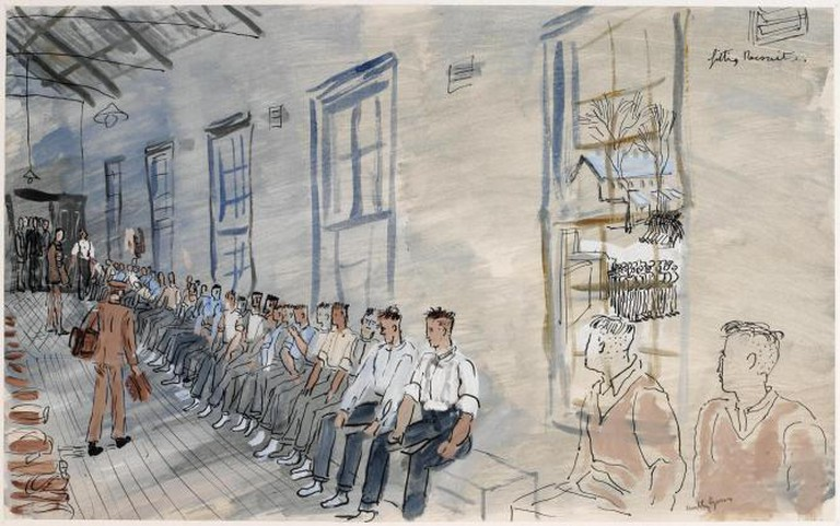 This scene was probably recorded during Gross' two weeks with the Guards Barracks at Caterham in Surrey. Recruits sit in a line in a windowed room waiting to be given their uniform. Two men distribute items of clothing to them.   Courtesy Imperial War Museum