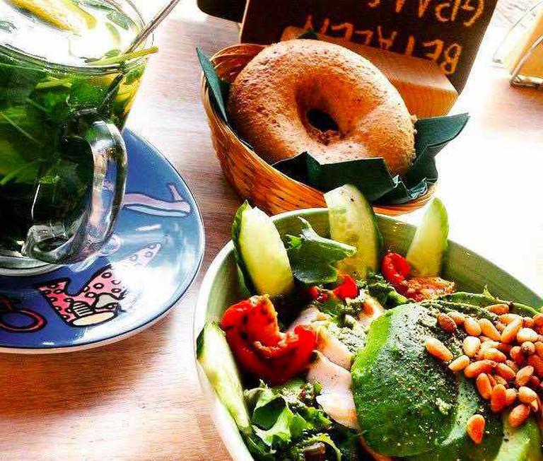 Bagel Breakfast: lots of avocado, healthy greens and warm tea