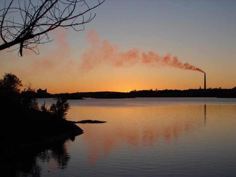 Sunset skyline of Sudbury, Ontario, Canada, with the Inco Superstack seen across Ramsey Lake.