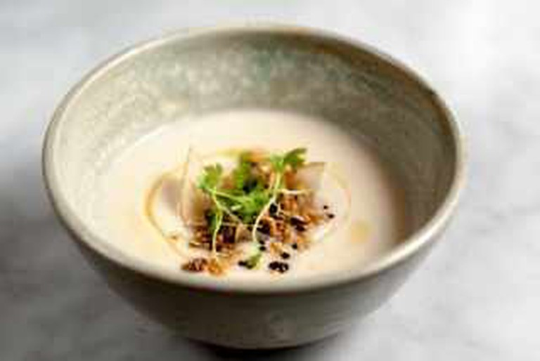 Celery Root Veloute with Coffee Butter, Oats and Asian Pear / Photograph by Albert   Law