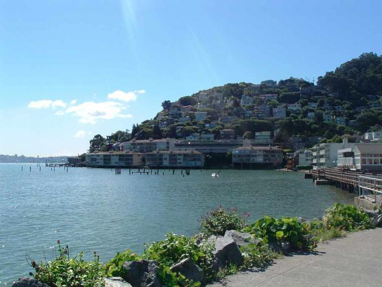 View of the Sausalito hillside and the SF skyline in the background from Bridgeway, near The Trident